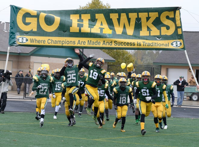 The Farmington Harrison Hawks take the field for the Division 4 predistirct game between Harrison and Cranbrook-Kingswood Oct. 27, 2018
