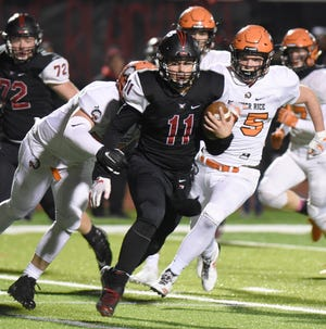 Churchill senior quarterback Drew Alsobrooks, an All-KLAA East Division pick, runs the ball during a pre-district game Oct. 26 against Brother Rice.