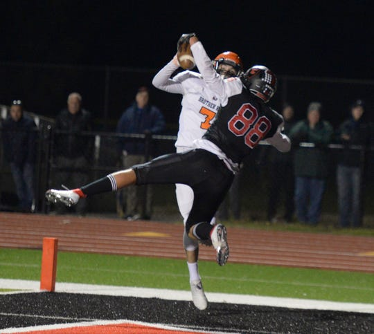Livonia Churchill TE Joel Forgacs (88) somehow came down with the ball for a TD during Region 4 predistirct game against Birmingham Brother Rice Oct. 26, 2018