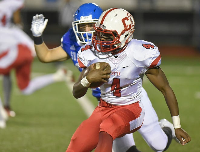 Canton running back Steven Walker (4) returns the opening kickoff against Detroit Catholic Central.