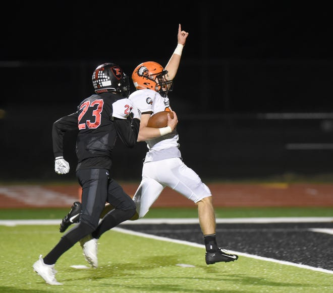 Birmingham Brother Rice RB James Donaldson (23) scores a TD during Region 4 predistirct game won by te Warriors 24-17 over Livonia Churchill  Oct. 26, 2018