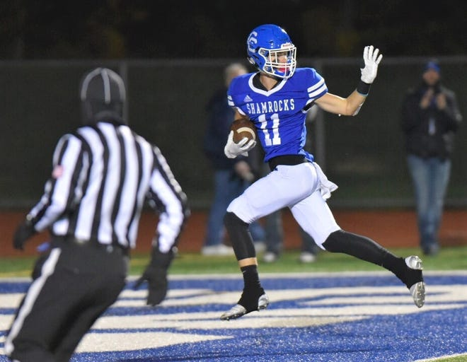Nate Anderson catches a TD pass in the first half against Canton.