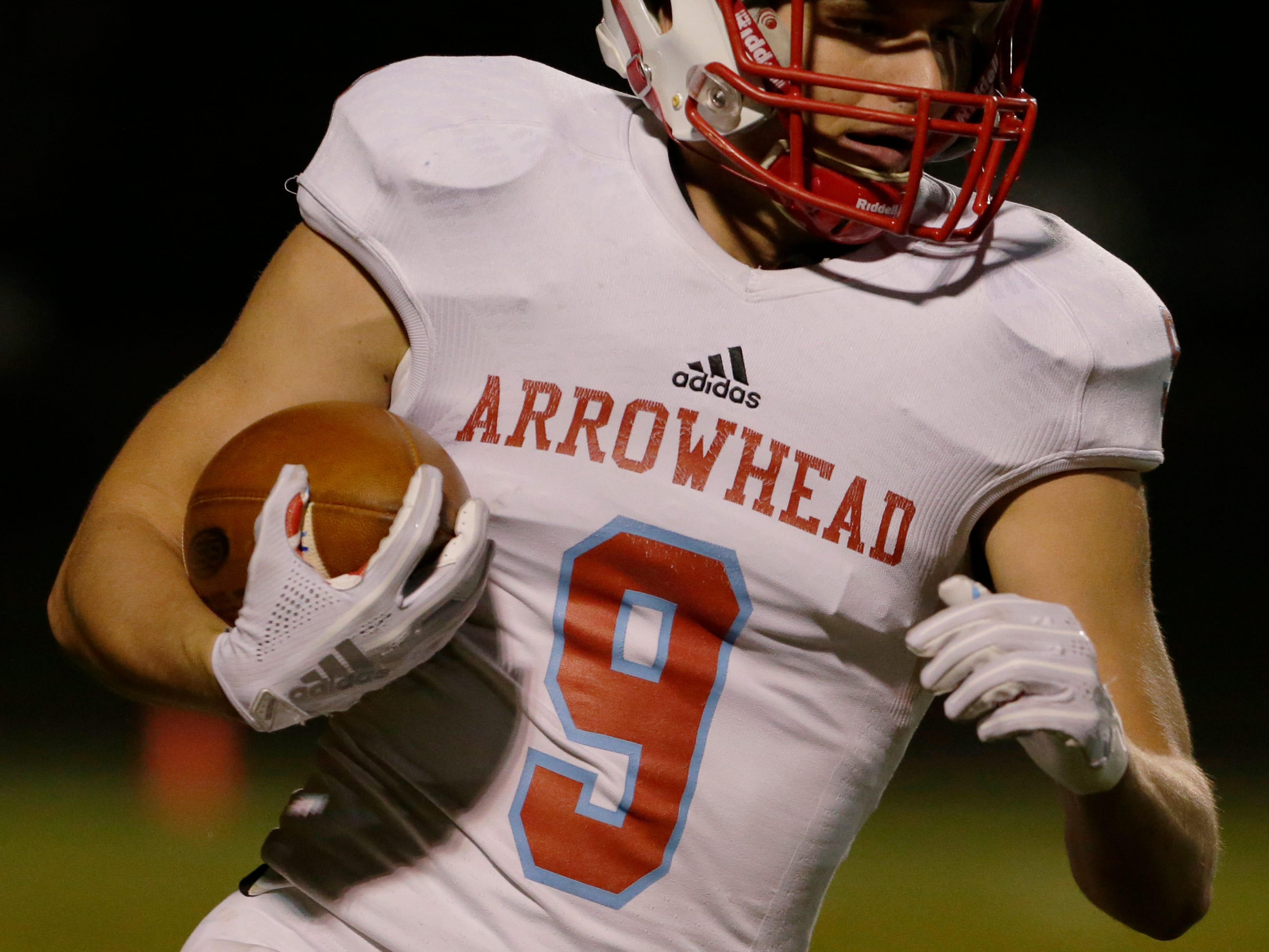 Arrowhead's Robbie Symdon returns a punt for the Warhawks.  Fond du Lac Cardinals played Arrowhead Warhawks in WIAA football playoff sectionals, Friday, Oct. 26, 2018, at Fruth Field in Fond du Lac.  Fond du Lac won 28 - 22.Joe Sienkiewicz/USA Today NETWORK-Wisconsin