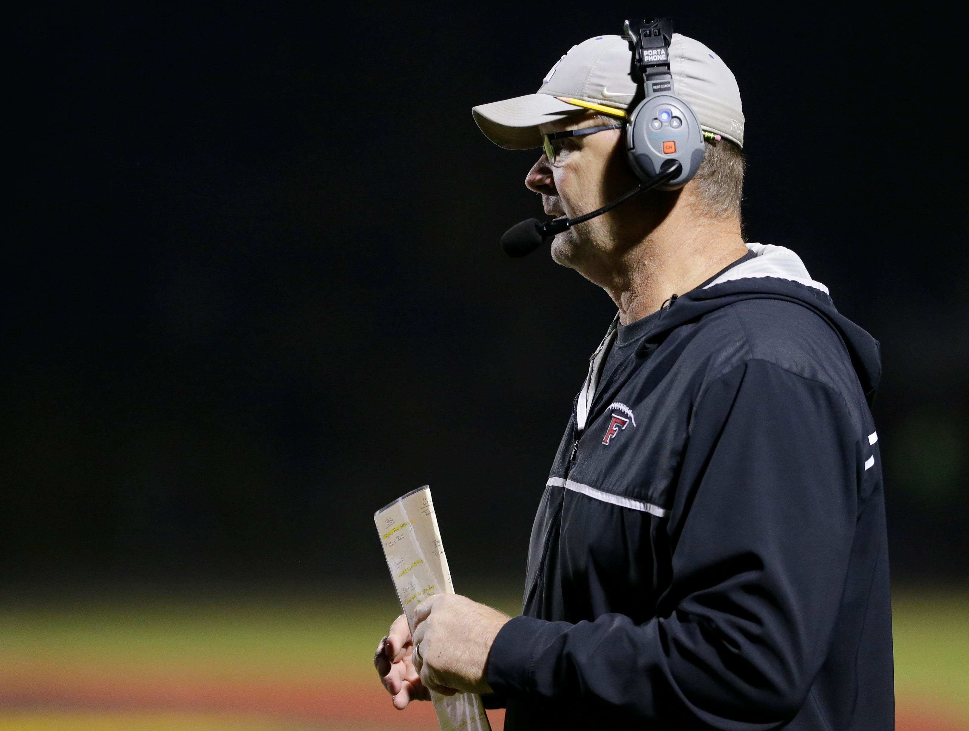 Fond du Lac's head coach Steve Jorgensen keeps an eye on his team during the game.  Fond du Lac Cardinals played Arrowhead Warhawks in WIAA football playoff sectionals, Friday, Oct. 26, 2018, at Fruth Field in Fond du Lac.  Fond du Lac won 28 - 22.Joe Sienkiewicz/USA Today NETWORK-Wisconsin