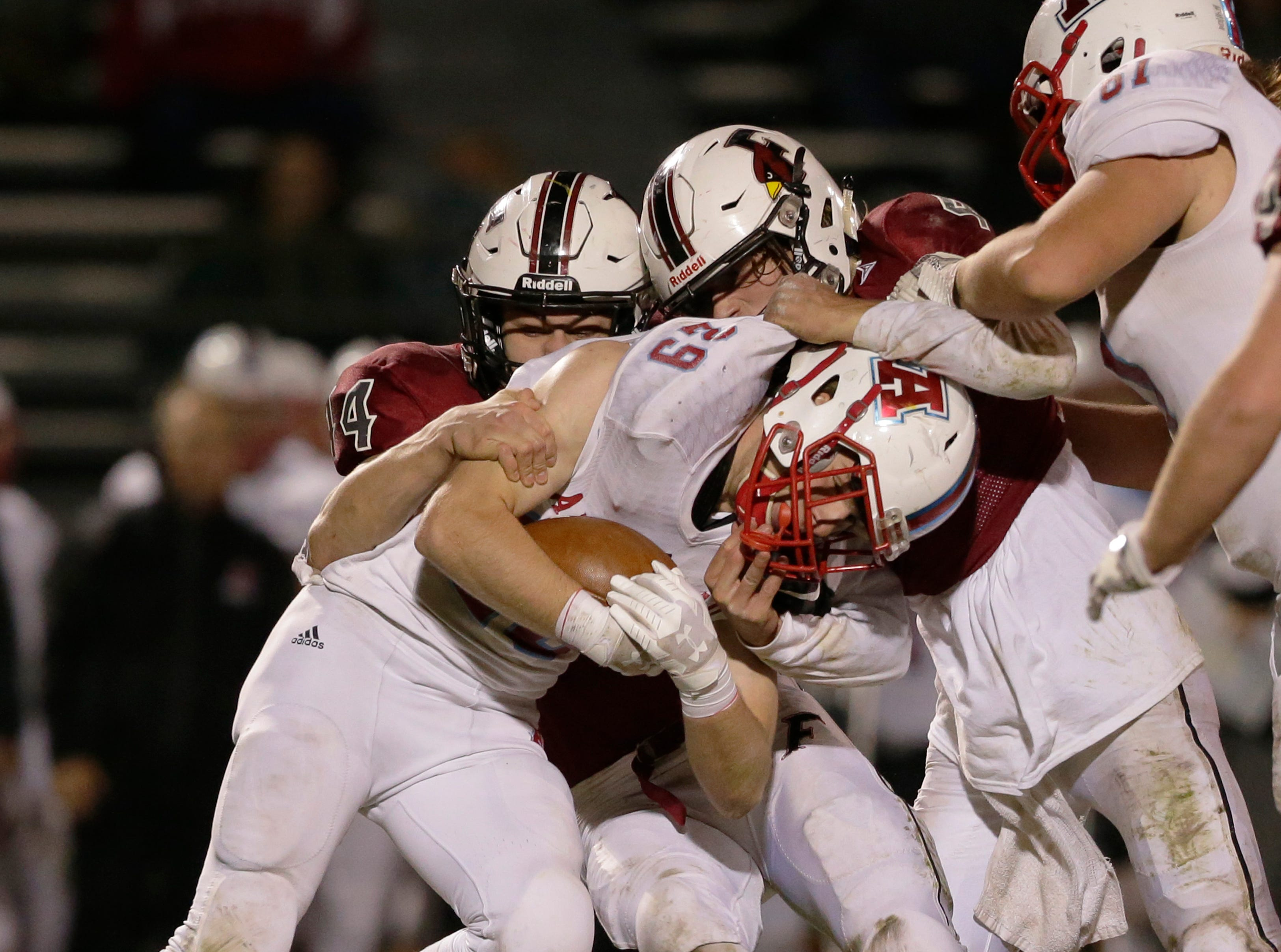 Arrowhead's Josh Nielsen is stopped by Fond du Lac's defense.  Fond du Lac Cardinals played Arrowhead Warhawks in WIAA football playoff sectionals, Friday, Oct. 26, 2018, at Fruth Field in Fond du Lac.Joe Sienkiewicz/USA Today NETWORK-Wisconsin