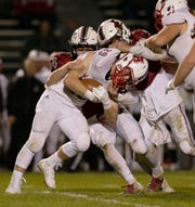 Arrowhead's Josh Nielsen is stopped by Fond du Lac's defense during Friday night's second-round playoff game at Fruth Field in Fond du Lac.