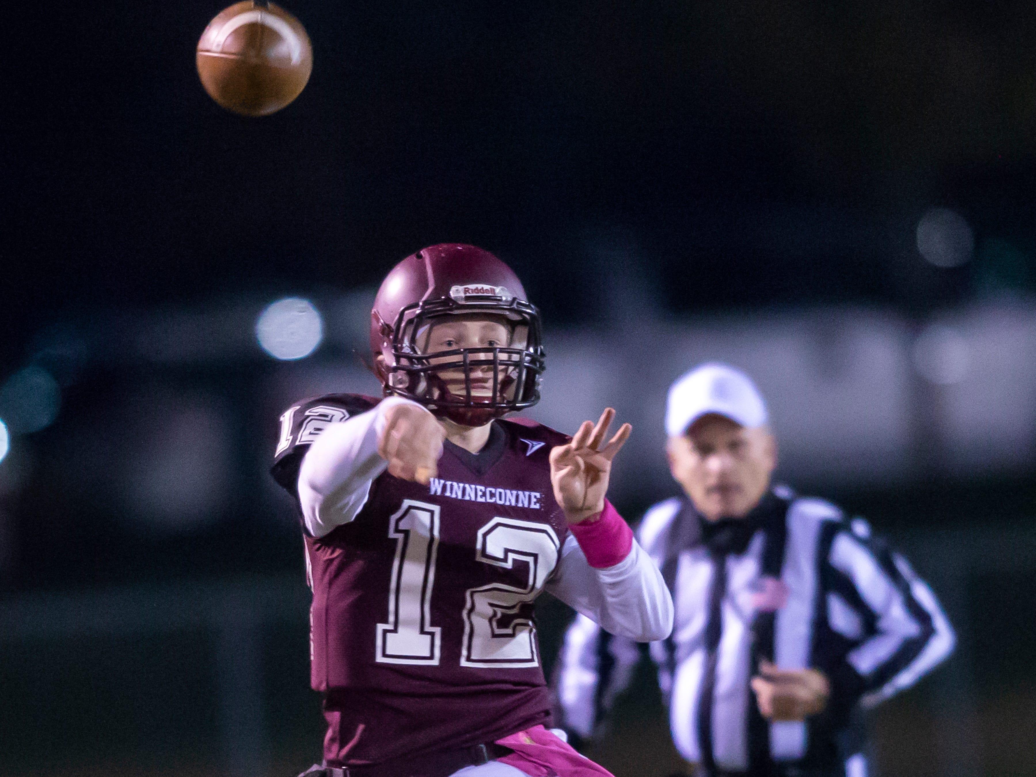Winneconne's Harrison Roubidoux throws a pass at Winneconne High School on Friday, October 26, 2018.