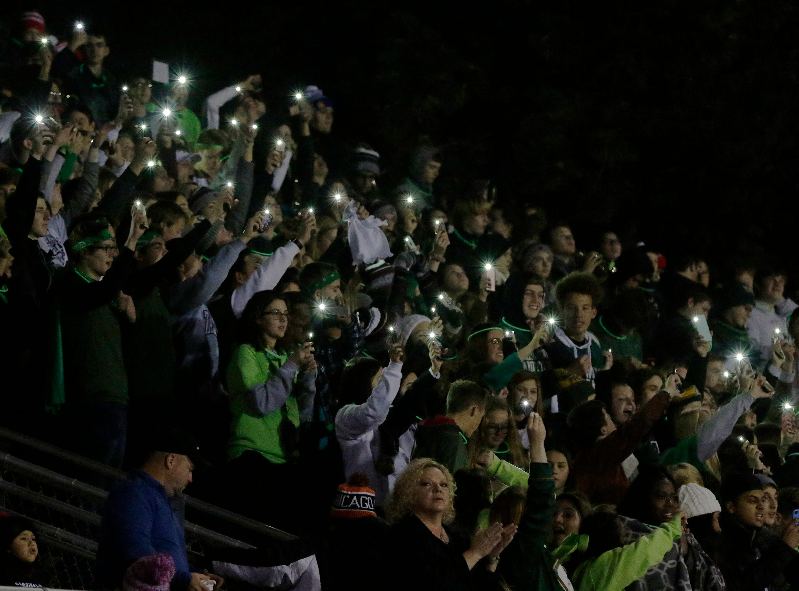 The Fond du Lac student section raised their lights after their team won 28 -22 over Arrowhead.  Fond du Lac Cardinals played Arrowhead Warhawks in WIAA football playoff sectionals, Friday, Oct. 26, 2018, at Fruth Field in Fond du Lac.Joe Sienkiewicz/USA Today NETWORK-Wisconsin