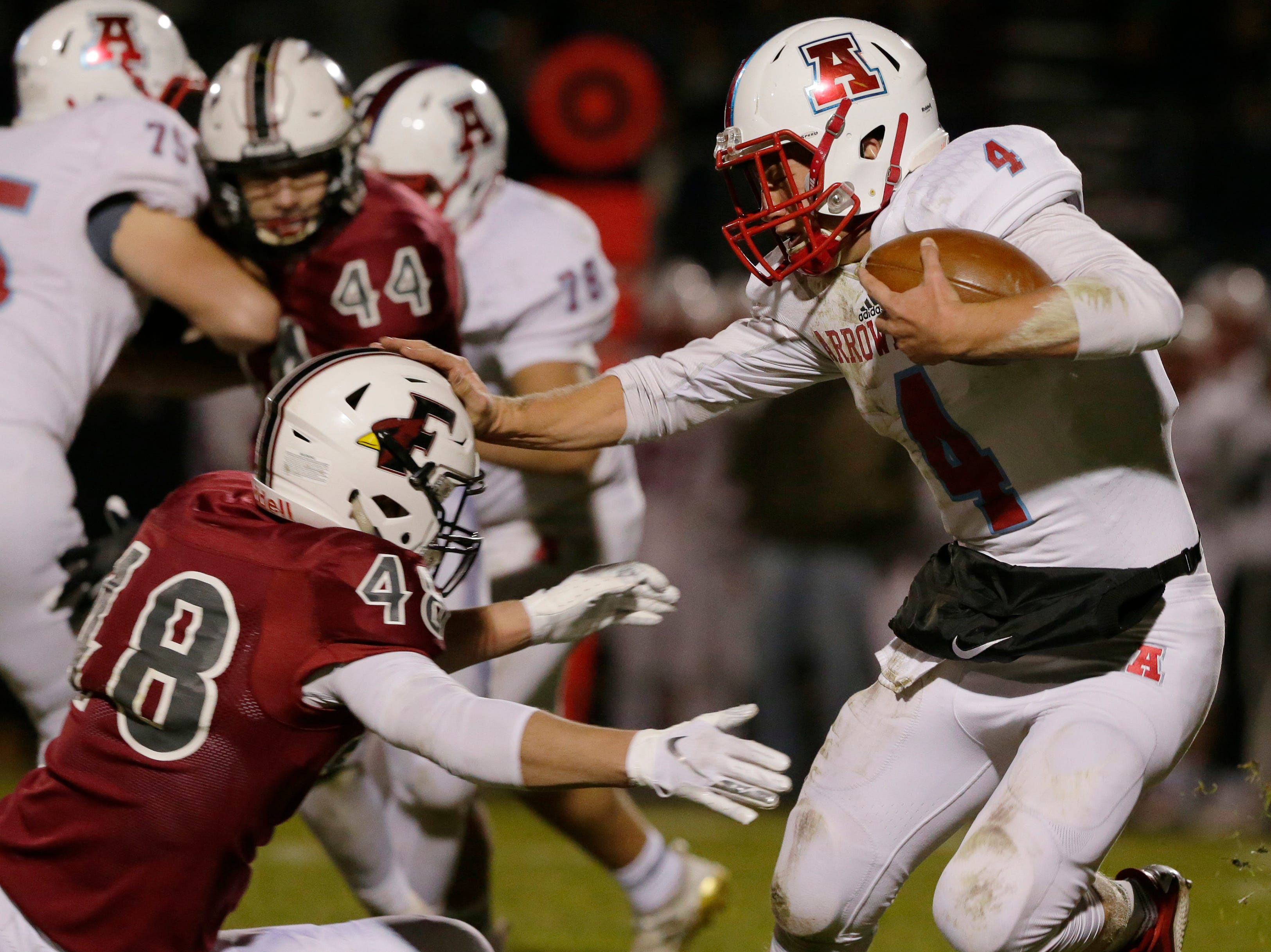 Arrowhead's Nic Wohlfiel runs the ball while stiff arming Fond du Lac's Adam Hopper during their game.  Fond du Lac Cardinals played Arrowhead Warhawks in WIAA football playoff sectionals, Friday, Oct. 26, 2018, at Fruth Field in Fond du Lac.  Fond du Lac won 28 - 22.Joe Sienkiewicz/USA Today NETWORK-Wisconsin