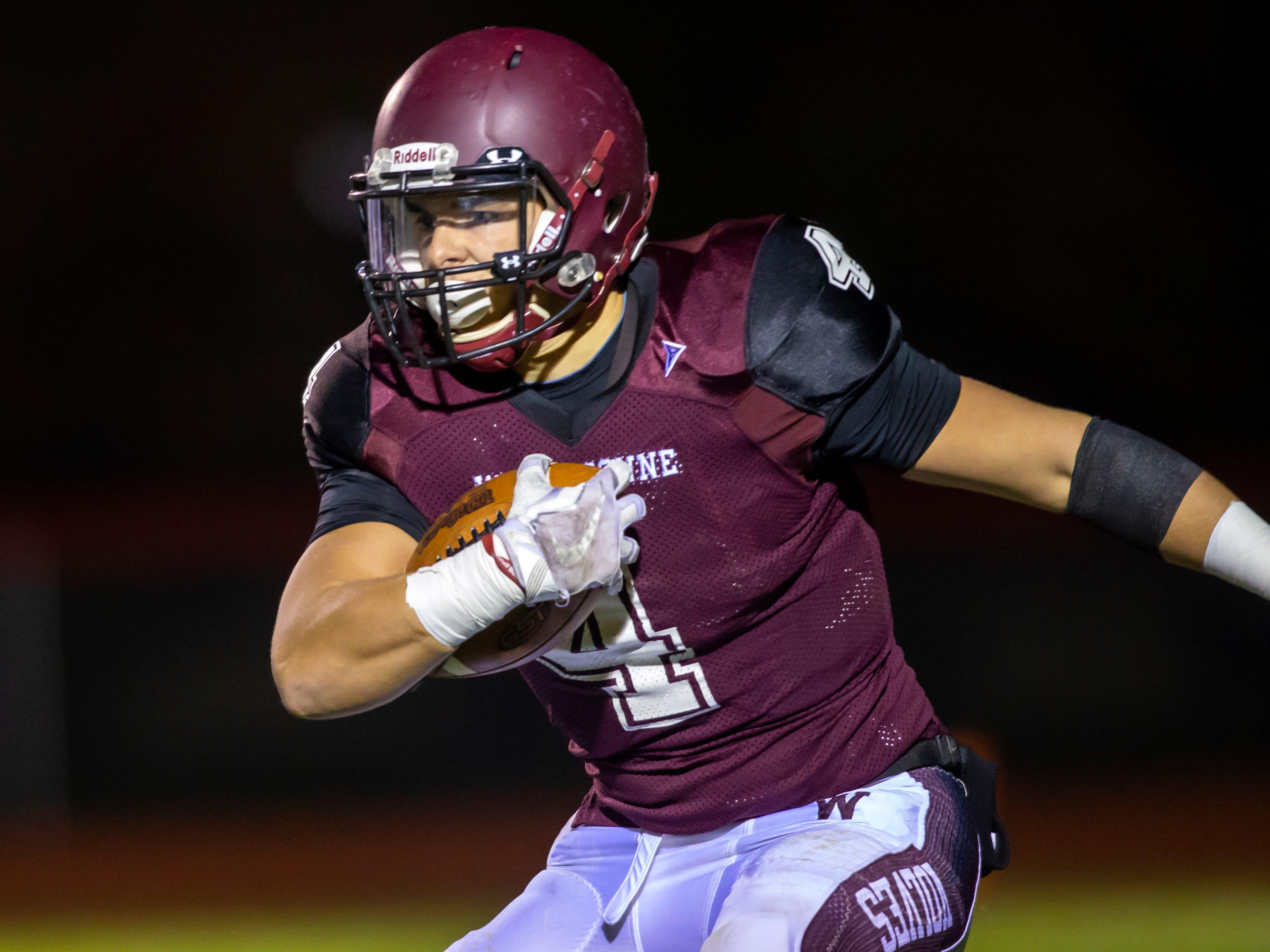 Winneconne's Austin Hecker runs the ball at Winneconne High School on Friday, October 26, 2018.