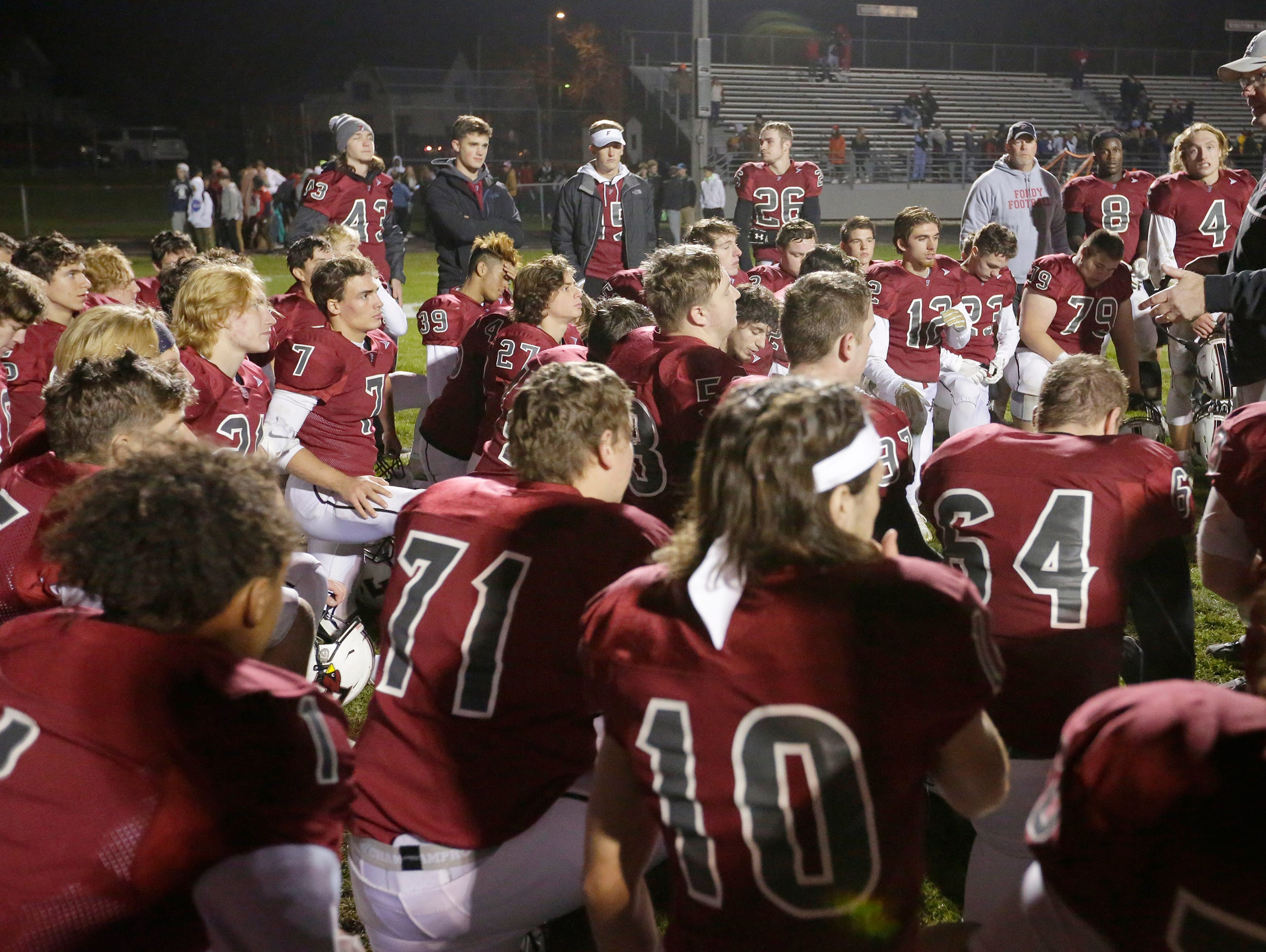 Fond du Lac's head coach Steve Jorgensen talks wi the team after they defeated Arrowhead 28 - 22.  Fond du Lac Cardinals played Arrowhead Warhawks in WIAA football playoff sectionals, Friday, Oct. 26, 2018, at Fruth Field in Fond du Lac.Joe Sienkiewicz/USA Today NETWORK-Wisconsin