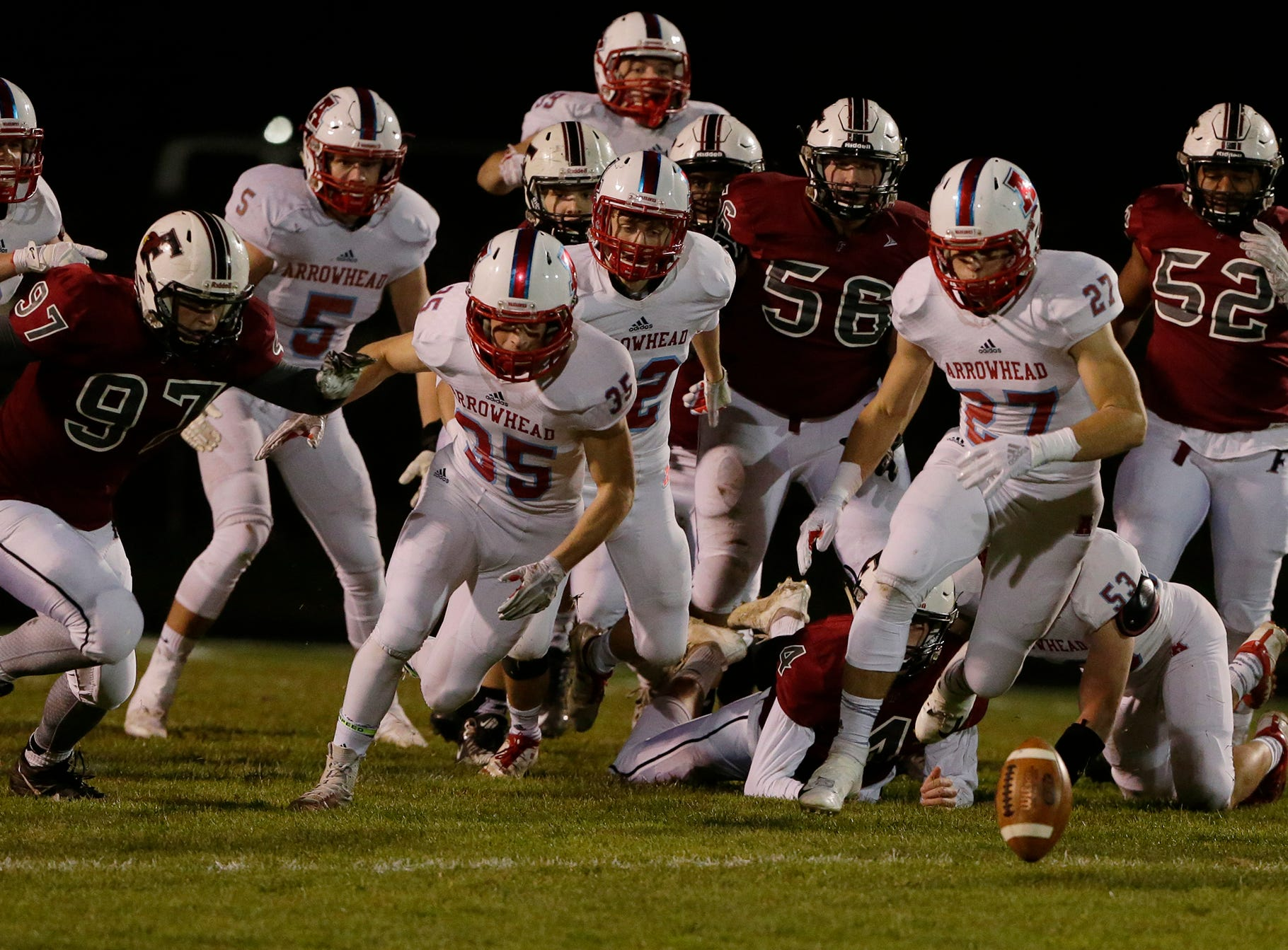 Everyone goes after the Fond du Lac fumble which was recovered by the Cardinals.  Fond du Lac Cardinals played Arrowhead Warhawks in WIAA football playoff sectionals, Friday, Oct. 26, 2018, at Fruth Field in Fond du Lac.    Fond du Lac won 28 - 22.Joe Sienkiewicz/USA Today NETWORK-Wisconsin