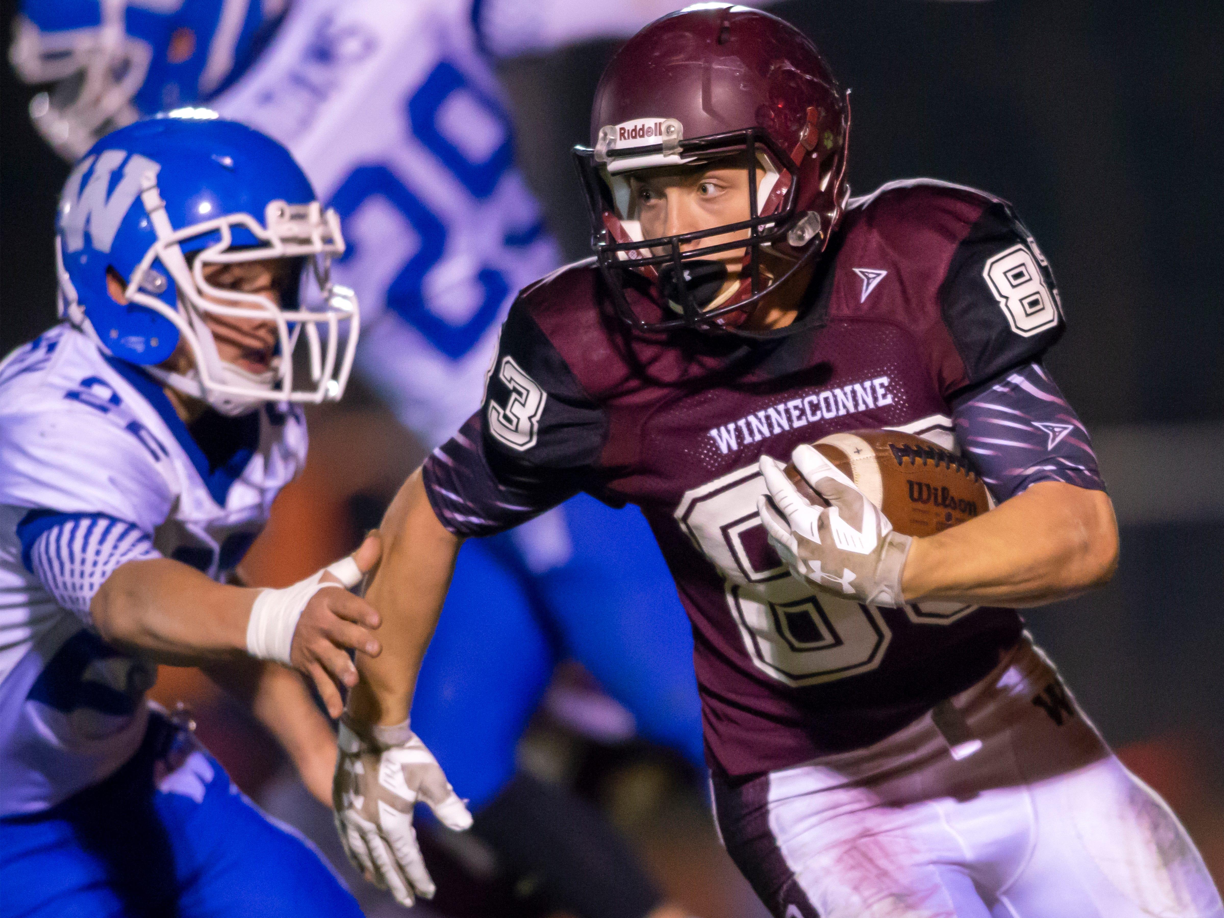 Winneconne's Jacob Omitt runs the ball around Wrightstown traffic at Winneconne High School on Friday, October 26, 2018.