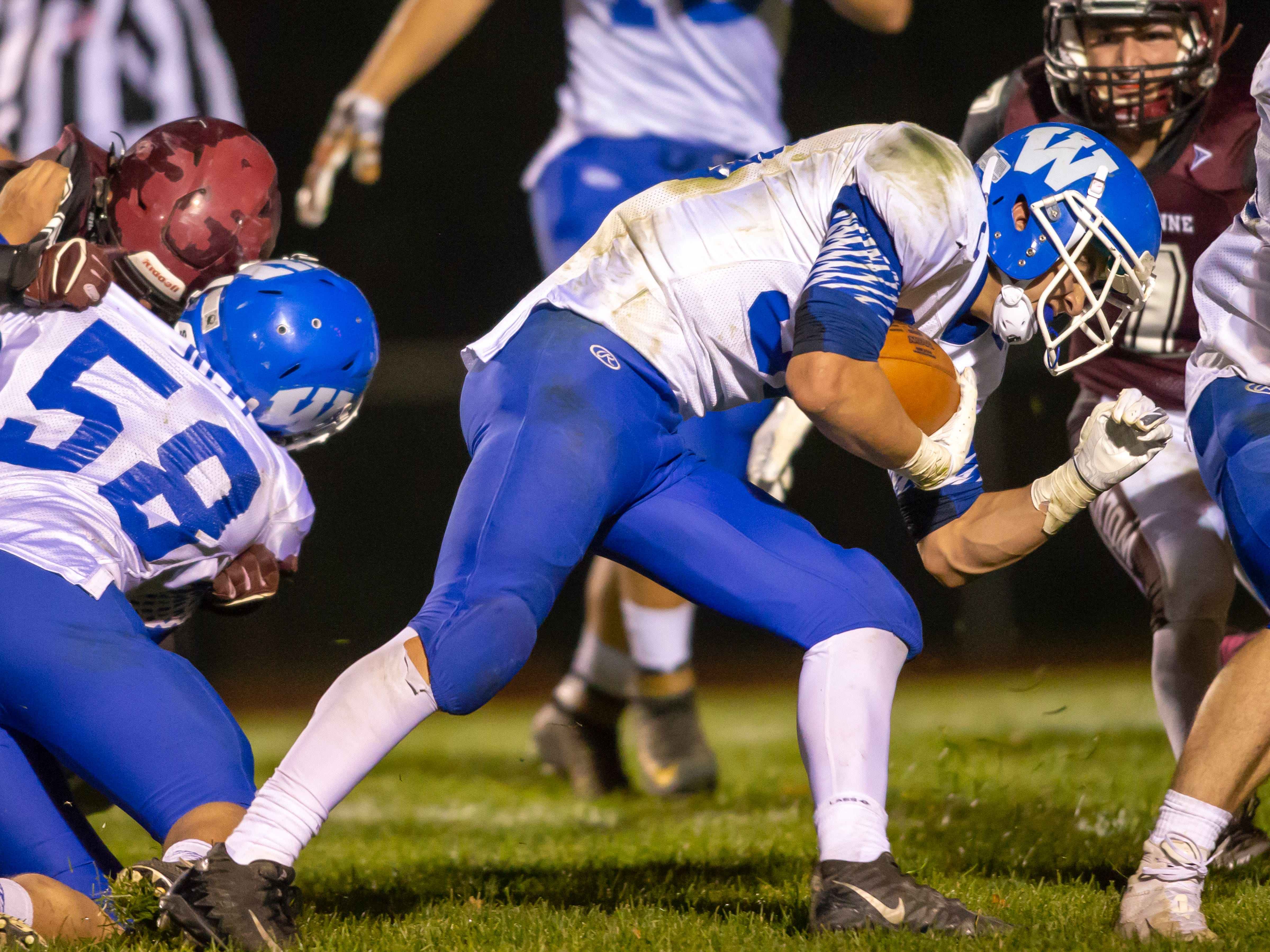 Wrightstown's Jeremy Van Zeeland pushes the ball forward playing against the Wolves at Winneconne High School on Friday, October 26, 2018.