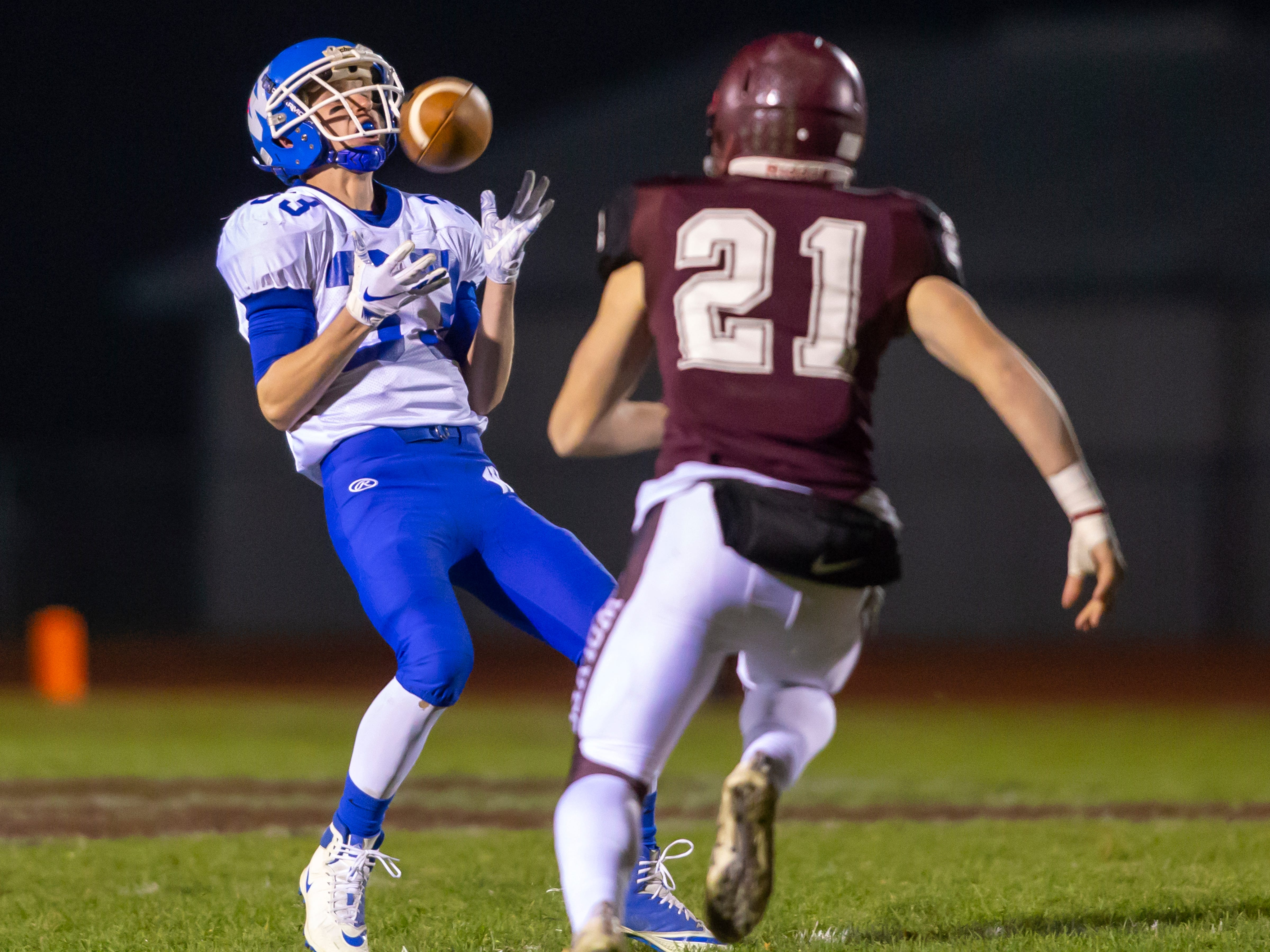 Wrightstown's Will Braeger catches the punt by Winneconne at Winneconne High School on Friday, October 26, 2018.