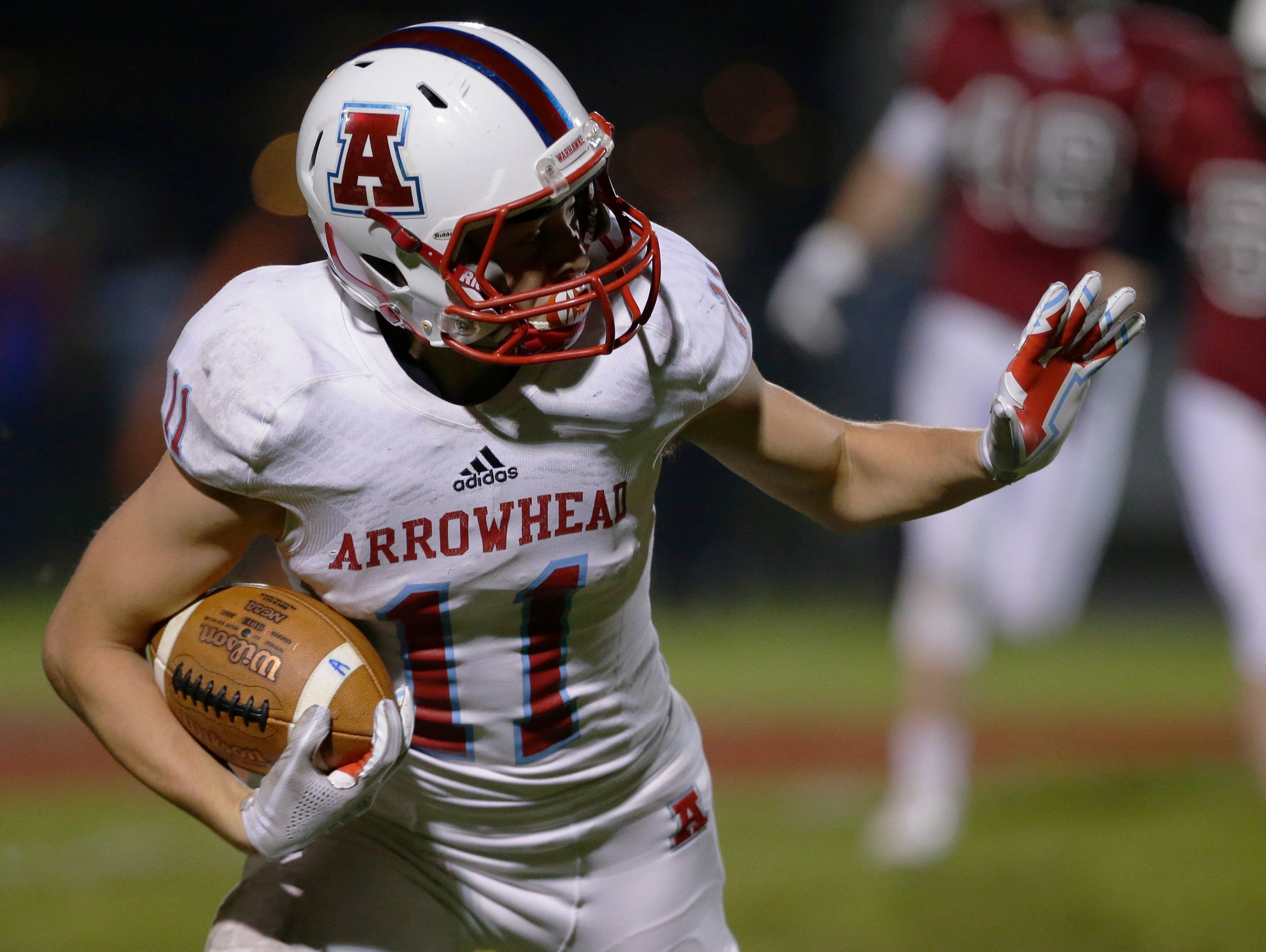 Arrowhead's Jacob Schleicher runs the ball after a punt.  Fond du Lac Cardinals played Arrowhead Warhawks in WIAA football playoff sectionals, Friday, Oct. 26, 2018, at Fruth Field in Fond du Lac.Joe Sienkiewicz/USA Today NETWORK-Wisconsin