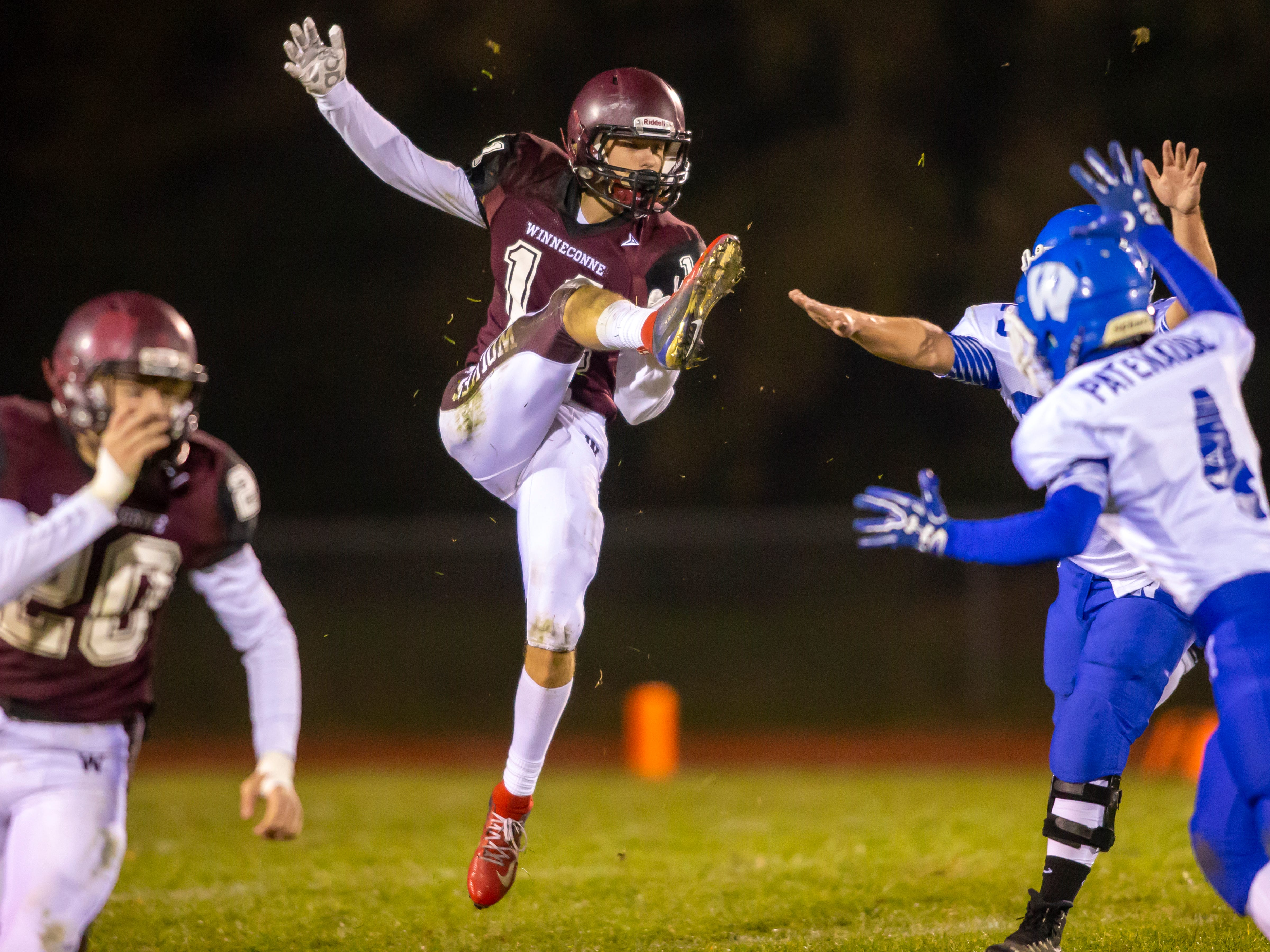 Winneconne's Evan Miller punts the ball to Wrightstown at Winneconne High School on Friday, October 26, 2018.