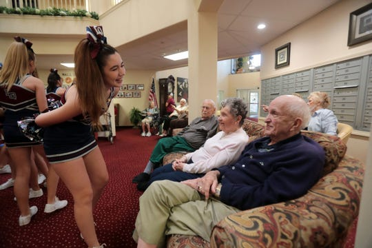 La Quinta High senior Savannah Ortega chat with Jerry Ayliffe, 94, and Ginger Bolton, 91, during a Blackhawks cheer-squad and football team pep rally for the seniors at The Palms at La Quinta Independent Living Facility on Thursday, October 25, 2018 in La Quinta. The senior were also invited to the La Quinta Xavier Prep football game on Friday.