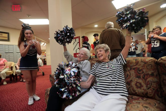 Seniors try cheering at The Palms at La Quinta Independent Living Facility on Thursday, October 25, 2018 in La Quinta during a La Quinta High School cheer-squad and football team a pep rally for the seniors.