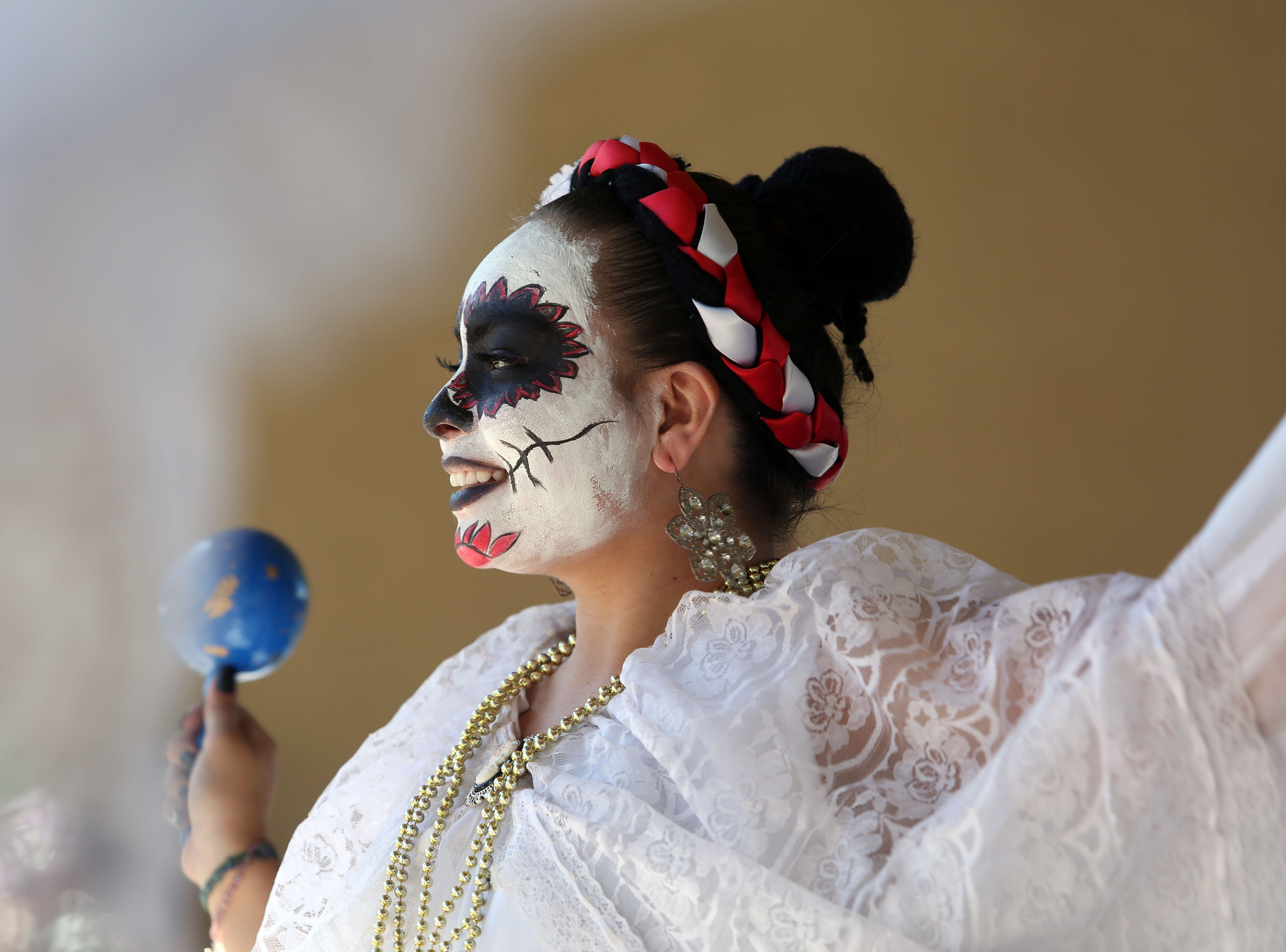 Folklorico dancers from Cathedral City High School perform at Cathedral City's annual Dia de los Muertos celebration at Desert Memorial Park cemetery on Saturday, October 27, 2018.