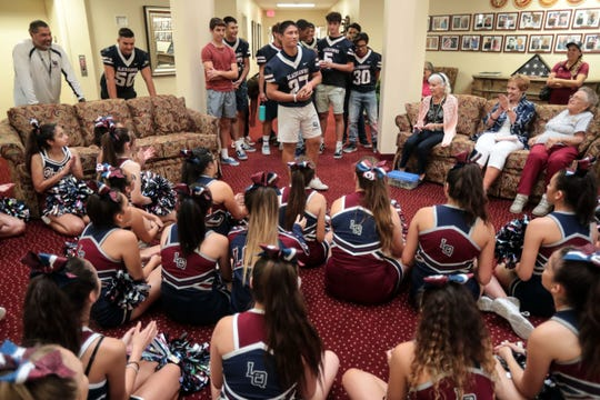 Members of the La Quinta football team introduce themselves to seniors at The Palms at La Quinta Independent Living Facility on Thursday, October 25, 2018 in La Quinta during a pep rally for the seniors.