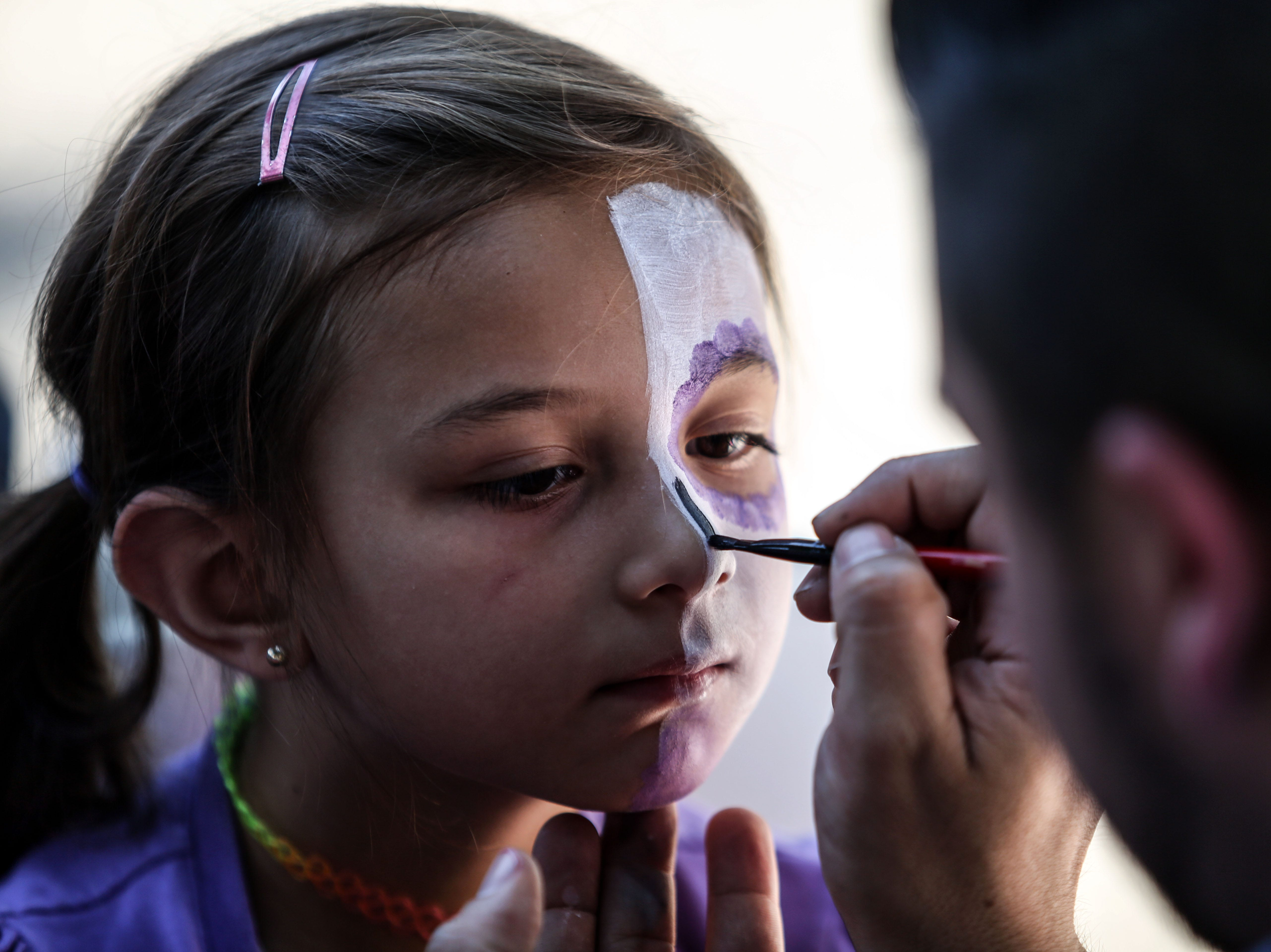 Shilo Alaniz, 5, has her face painted during Cathedral City's annual Dia de los Muertos celebration at Desert Memorial Park cemetery on Saturday, October 27, 2018.