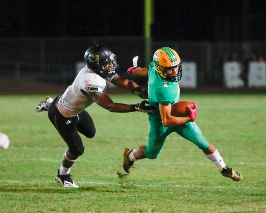 Coachella Valley's Sebastian Camarena runs Friday in the regular season finale against Banning.