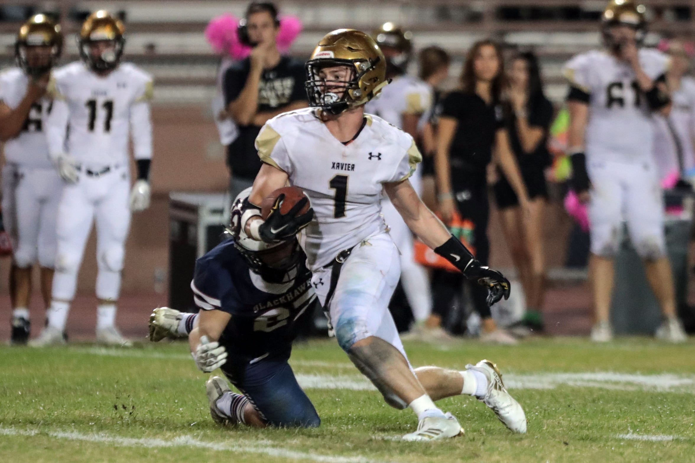 Xavier Prep's Tommy Branconier carries the ball against La Quinta on Friday, October 26, 2018 in La Quinta.