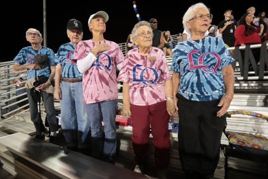 Members of The Palms at La Quinta Independent Living Facility stand for the National Anthem while attending the  La Quinta High School's homecoming football game on Thursday, October 25, 2018 in La Quinta.