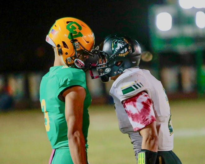 Coachella Valley quarterback Donny Fitzgerald (left) comes face to face with a player from Banning prior to Friday's regular season finale.