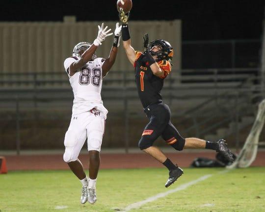 Jacob Mcilroy of Palm Desert breaks up a pass to Jayden Wilson of Rancho Mirage, October 26, 2018.