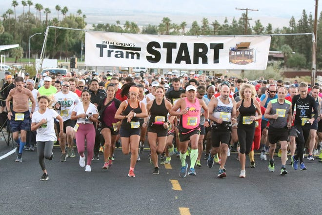 """Runners take off in the 33rd annual Tram Road Challenge in Palm Springs on Saturday, October 27, 2018. More than 1,300 runners and walkers participated in this year's race, billed as the """"World's Toughest 6K."""""""