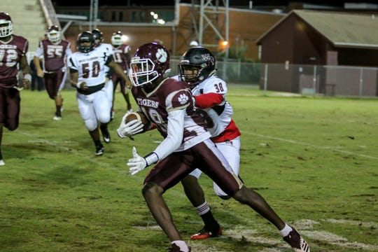 PHS' Ladarius Powell (18) runs up the field near the sideline against West Florida Tech in the District 1-5A matchup at Pensacola High School on Friday, October 26, 2018.