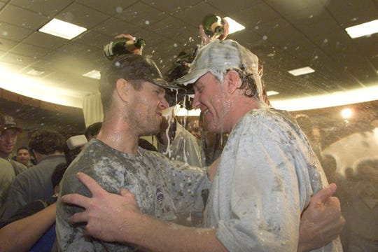4 Nov 2001:  Pitcher Curt Schilling #38 of the Arizona Diamondbacks celebrates with teammate Jay Bell after winning the World Series over the New York Yankees at Bank One Ballpark in Phoenix, Arizona. The Diamondbacks defeated the Yankees 3-2.