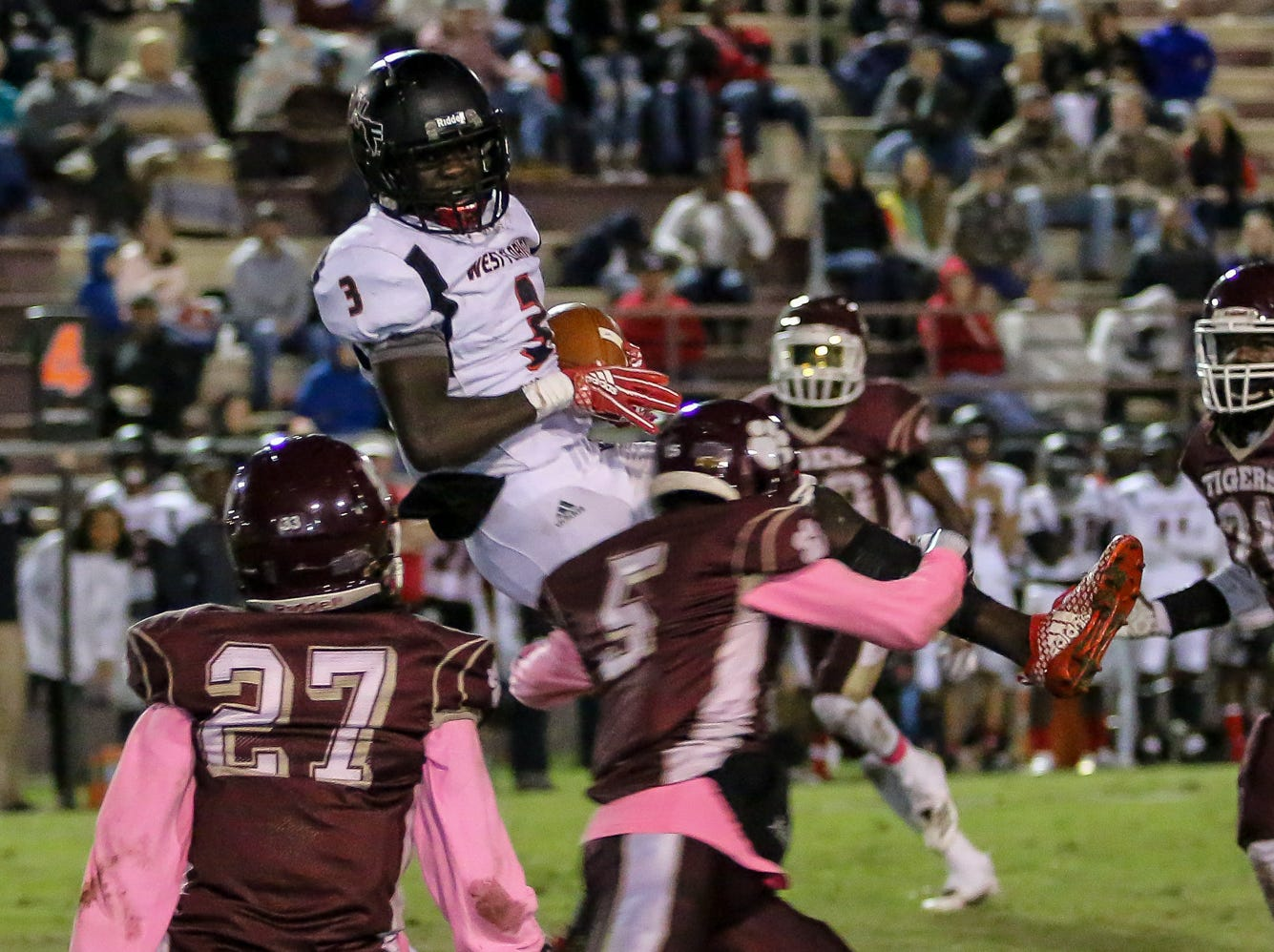 West Florida Tech's Keyshawn Swanson (3) makes a jumping catch before being tackled by PHS' Ernest Stallworth Jr. (5) in the District 1-5A matchup at Pensacola High School on Friday, October 26, 2018.