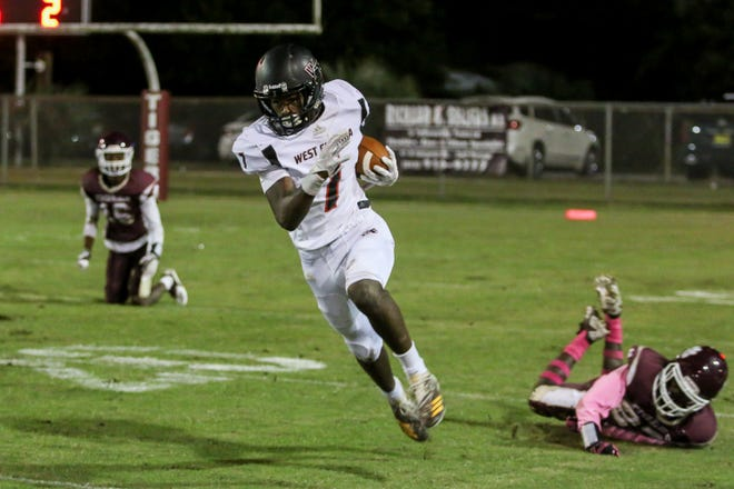 West Florida Tech's Keion Burrell (7) leaves a PHS defender behind as he races up the field in the District 1-5A matchup at Pensacola High School on Friday, October 26, 2018.