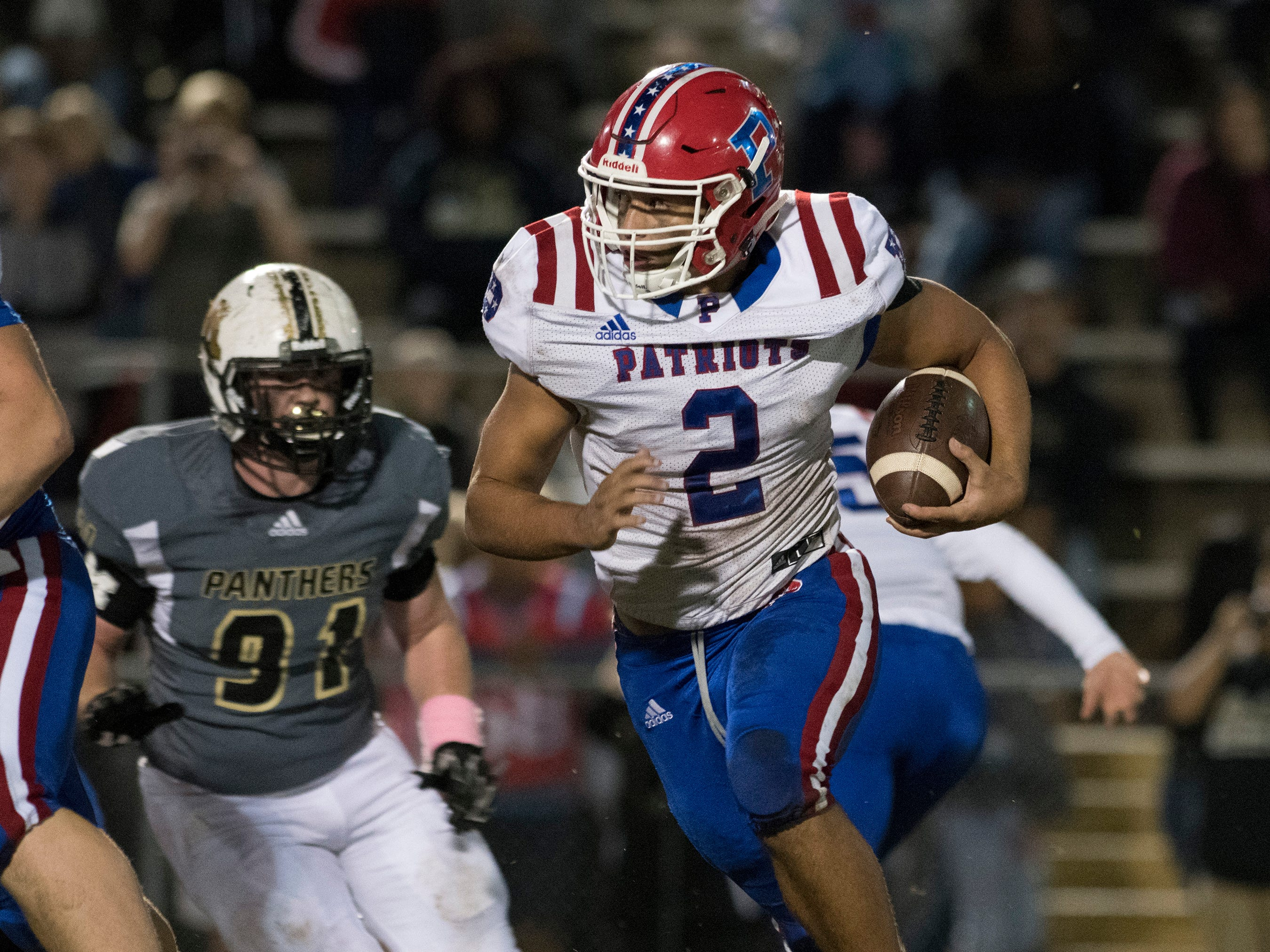 Pace High School's Damean Bivins (No. 2) slips past Milton's defense to rack up the yardage during Friday night's rivalry game.