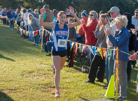 Pace Patriot Erica Fisher cross the finish line first Saturday, October 27, 2018 during the girls District 1-3A cross country championship at Sims Middle School.