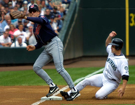 SEATTLE, UNITED STATES:  Seattle Mariners Bret Boone (R) slides safely into third base while stealing against Cleveland Indians Travis Fryman (L) during second inning play of their game, 03 August  2002, in Seattle, WA.  AFP PHOTO/Dan LEVINE (Photo credit should read DAN LEVINE/AFP/Getty Images)