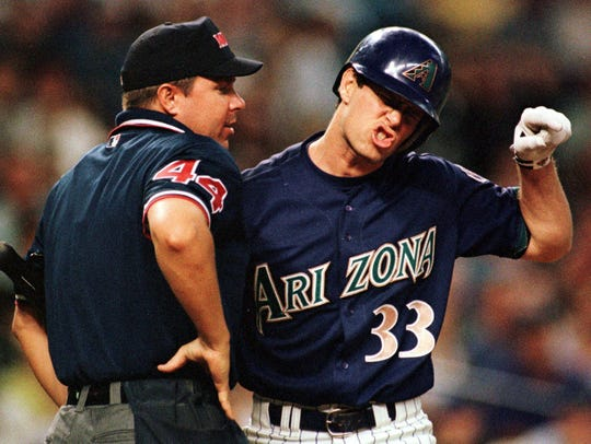 PHOENIX, AZ - JUNE 20:  Arizona Diamondbacks Jay Bell (R) argues with home plate umpire Doug Eddings after he struck out against San Diego Padres starting pitcher Brian Tollberg in the fifth inning, 20 June 2000, in Phoenix, Arizona. Bell was ejected from the game for the outburst.  (Photo credit should read MIKE FIALA/AFP/Getty Images)