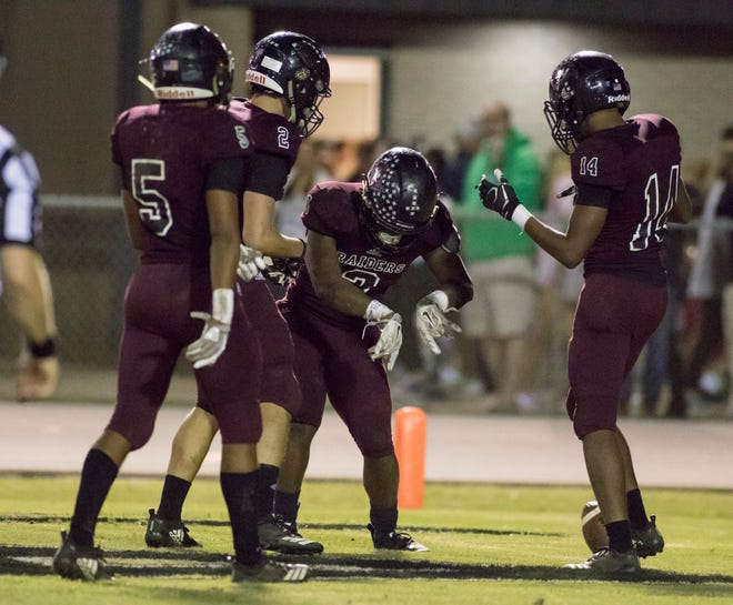 The Raiders do a celebratory dance after scoring a touchdown during the Gulf Breeze vs Navarre football game at Navarre High School on Friday, October 26, 2018.