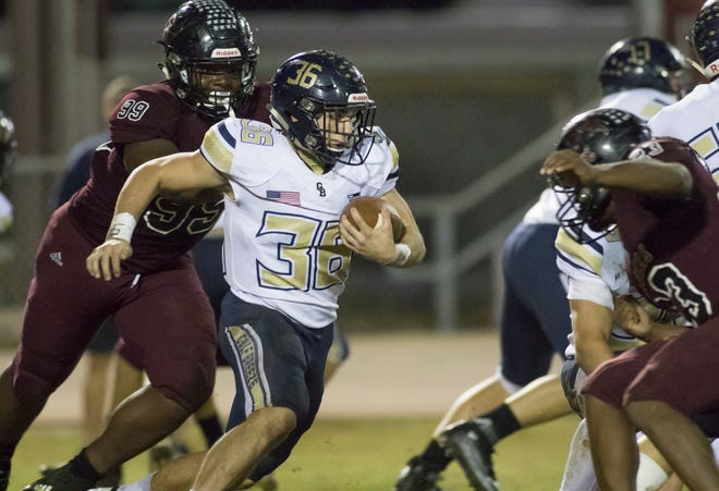 Tyler Dittmer (36) looks for an opening during the Gulf Breeze vs Navarre football game at Navarre High School on Friday, October 26, 2018.