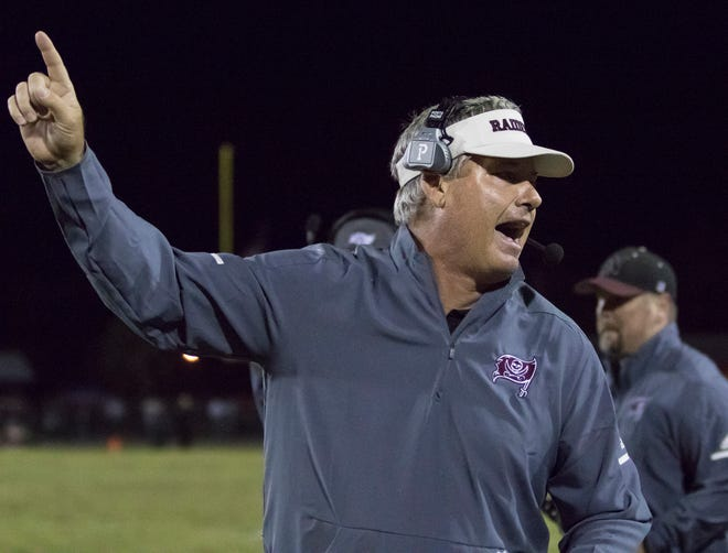 Raiders head coach Jay Walls calls for a 1-point attempt after a touchdown during the Gulf Breeze vs Navarre football game at Navarre High School on Friday, October 26, 2018.