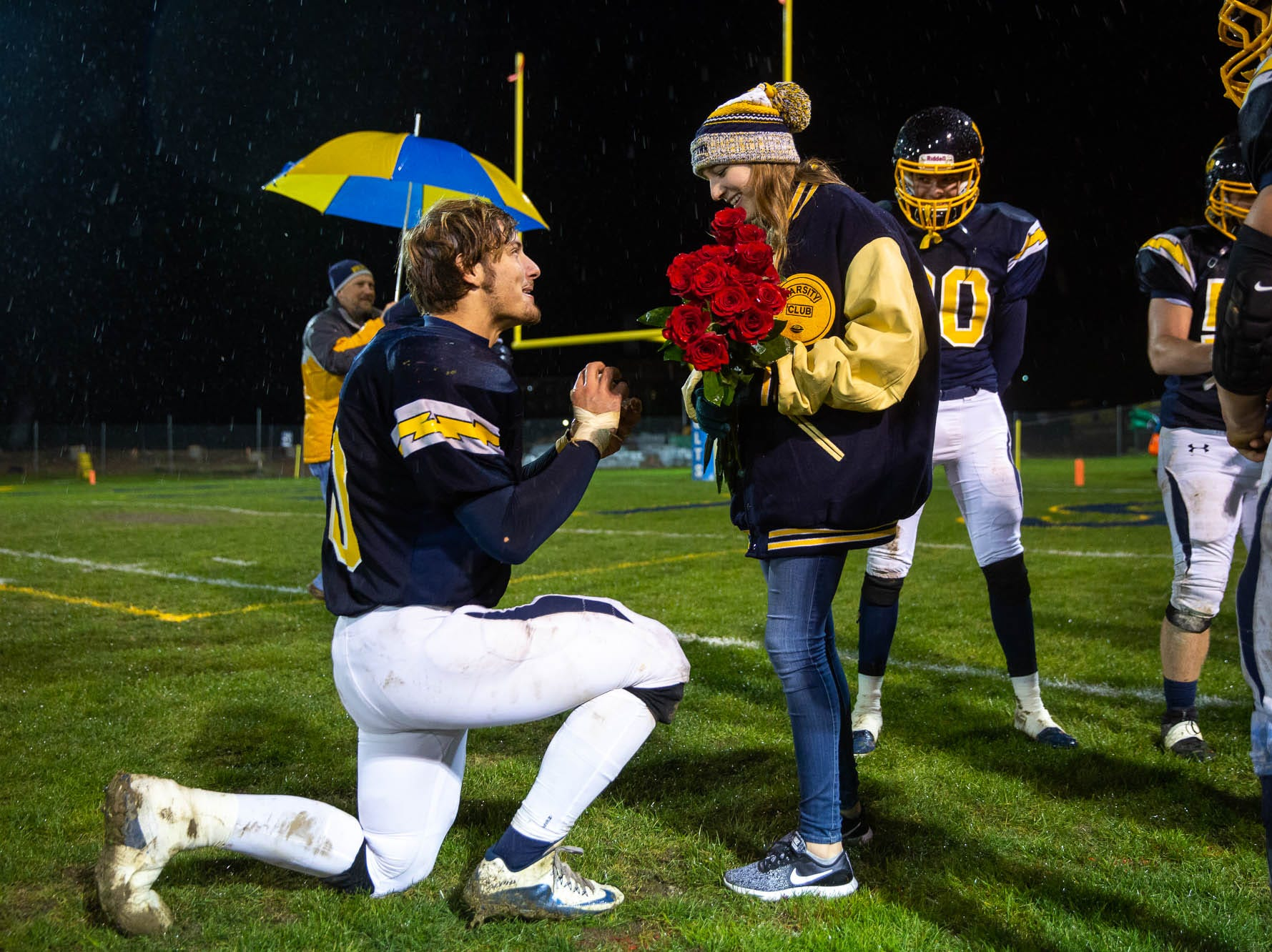 Littlestown's Malachi Fodor (70) proposes to his girlfriend, Miriam Worley, after winning a game against Fairfield, Friday, Oct. 26, 2018, at Littlestown's Memorial Stadium.