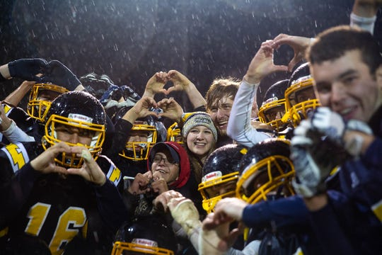 The Littlestown Bolts pose for a photo with Littlestown's Malachi Fodor (70) and girlfriend, Miriam Worley, after Fodor proposed to Worley following a game against Fairfield, Friday, Oct. 26, 2018, at Littlestown's Memorial Stadium.