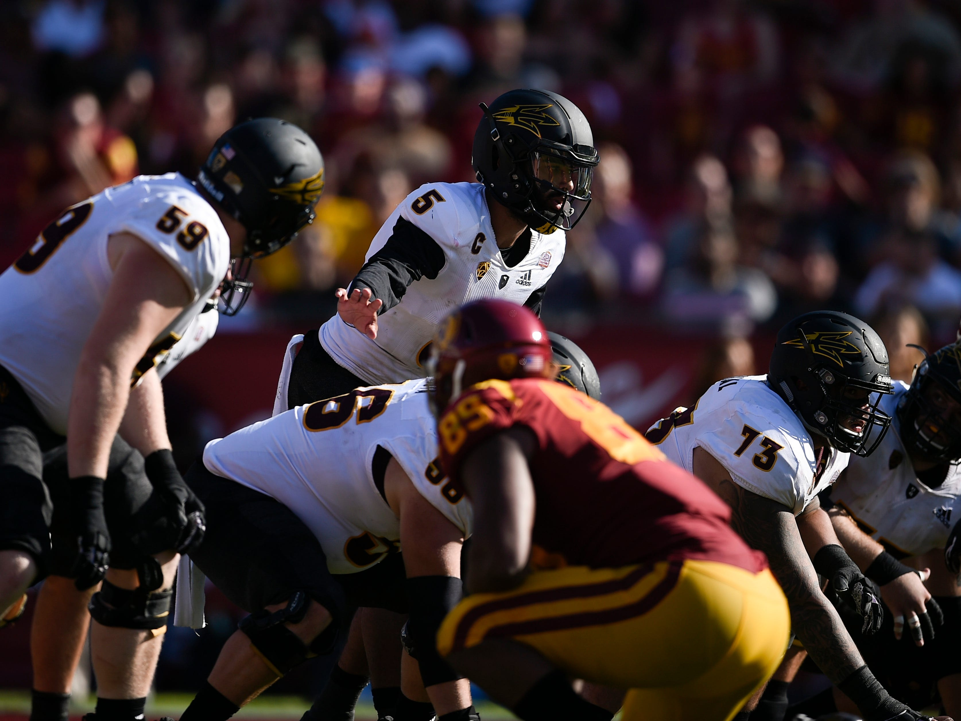 Oct 27, 2018; Los Angeles, CA, USA; Arizona State Sun Devils quarterback Manny Wilkins (5) prepares to snap the ball against the Southern California Trojans during the second half at Los Angeles Memorial Coliseum. Mandatory Credit: Kelvin Kuo-USA TODAY Sports