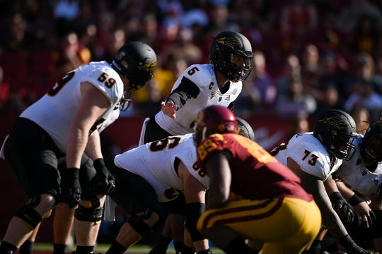 Manny Wilkins surveys the field before the snap during ASU's victory over USC 38-35 at the Los Angeles Memorial Coliseum.
