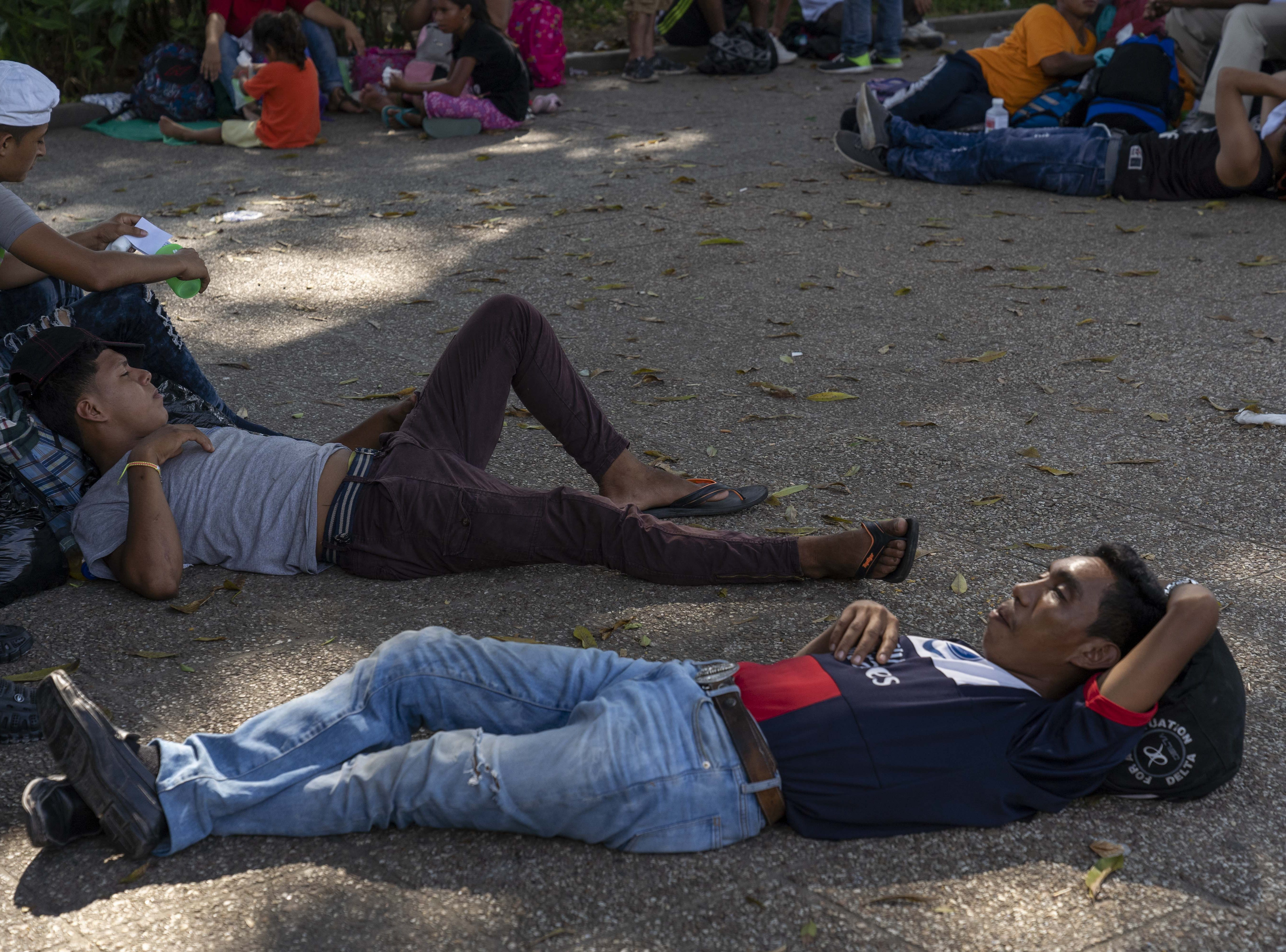 Several hundred migrants from Honduras and El Salvador gather near a park in Tecun Uman, Guatemala. They wait to cross the Suchiate River that divides Guatemala and Mexico in hopes of heading north to the United States. Under pressure from the United States, Mexico shut a bridge in an effort to halt the migrants, mostly Hondurans, from crossing the border into Mexico.