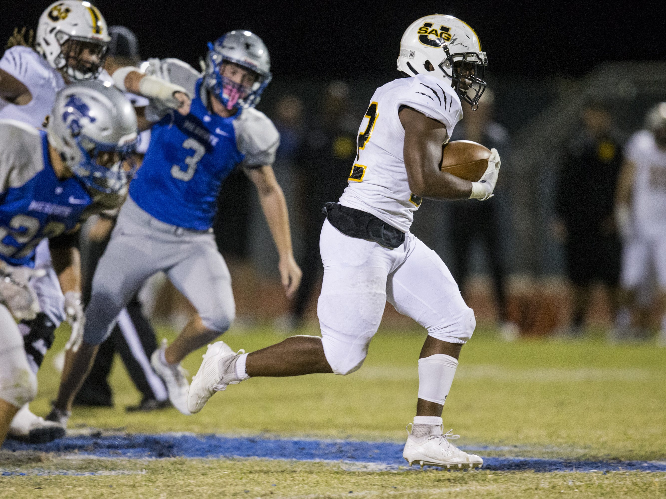Saguaro's Israel Benjamin rushes for a touchdown against Mesquite in the first half on Friday, Oct. 26, 2018, at Mesquite High School in Gilbert, Ariz.  #azhsb
