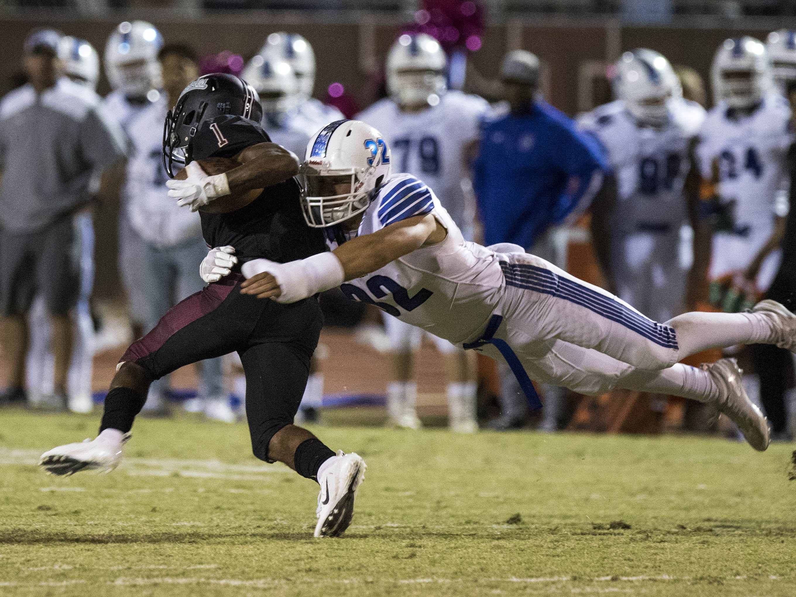 Chandler's Tate Romney makes a diving tackle against Hamilton's Pierre Taylor during their game in Chandler, Friday, Oct. 26, 2018. #azhsfb